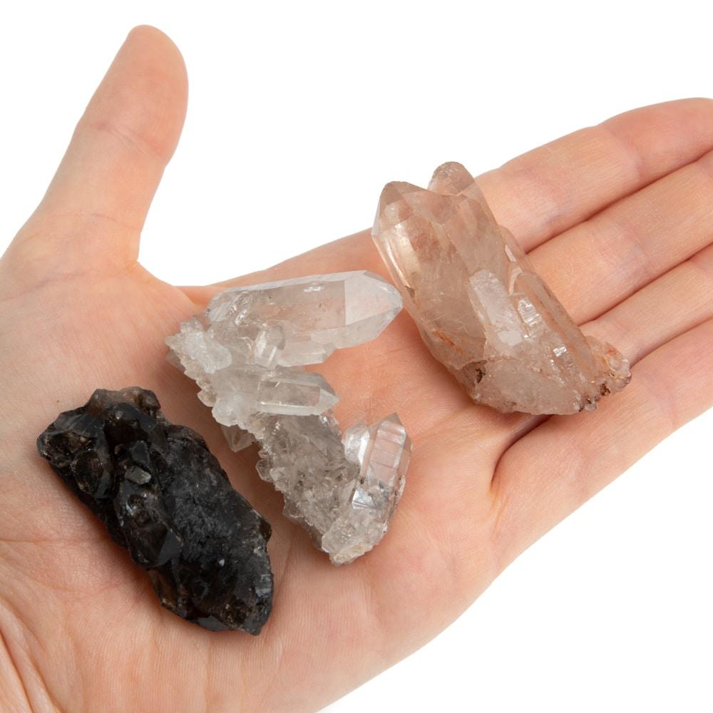 raw gemstones quartz in hand