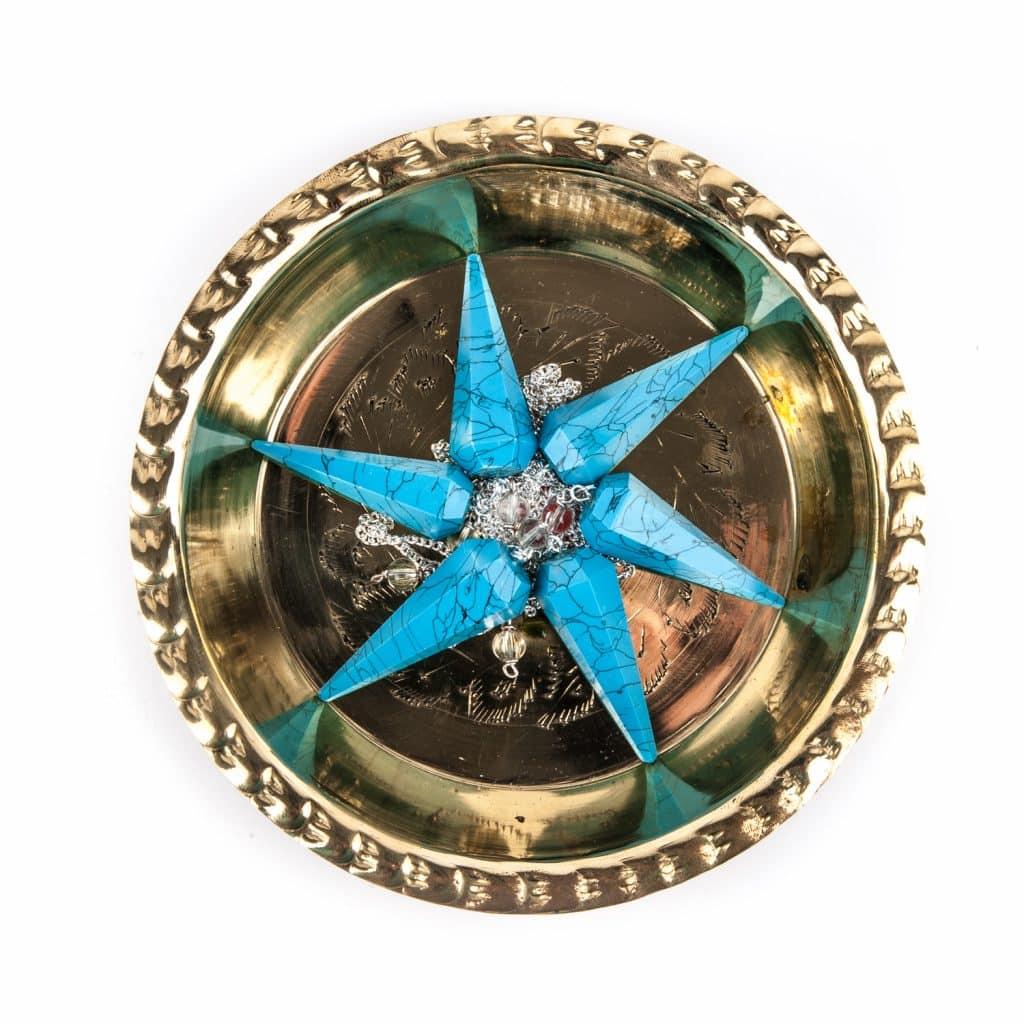 turquoise pendulum in gold bowl