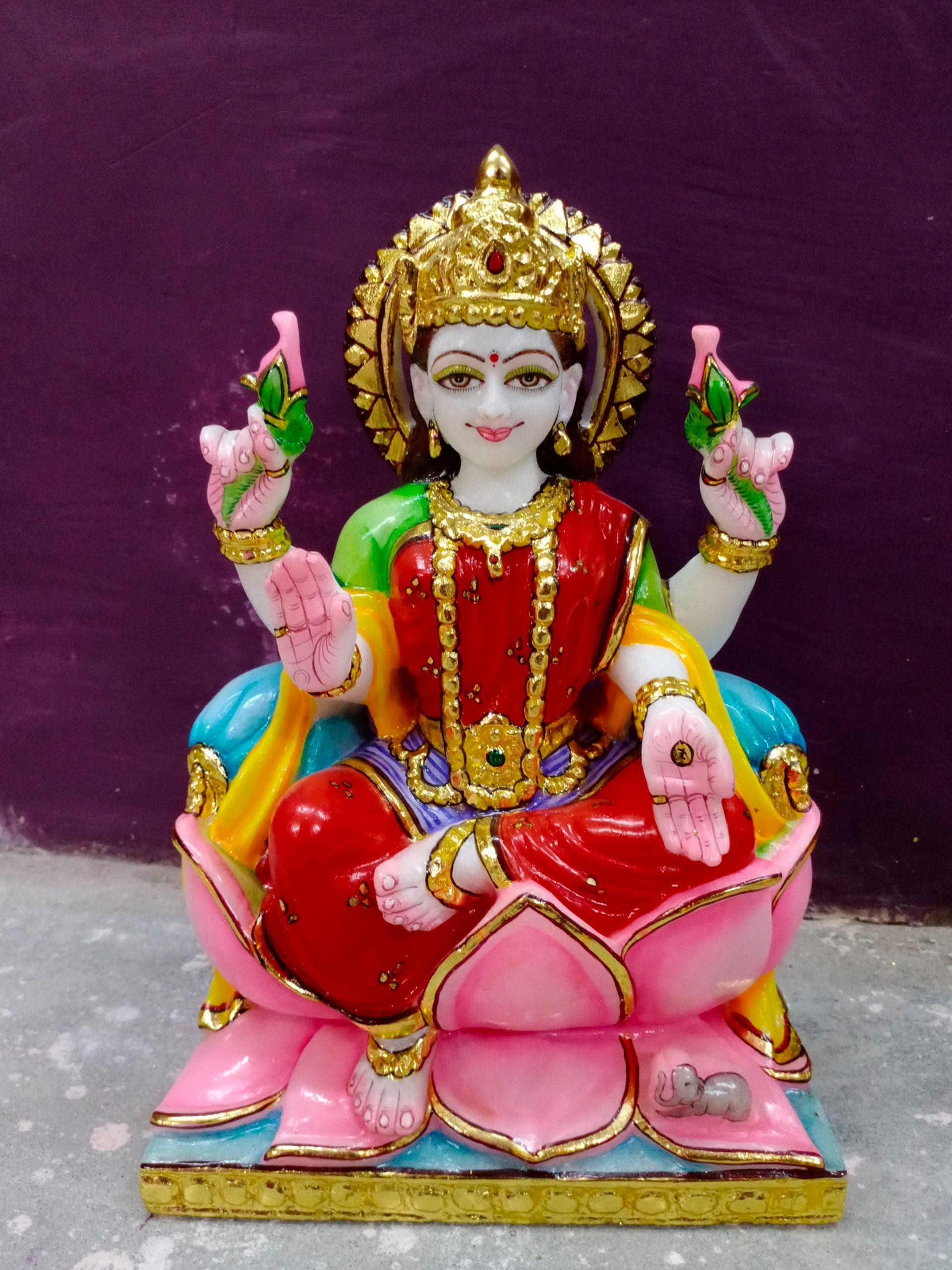 lakshmi seated in a lotus